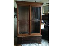 Lovely old bookcase for sale with antique wavy glass.