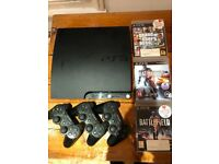 PS3 Slim Incl. 3x Controllers, 3x Games