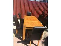 Large oak dining table plus 6 chairs for sale
