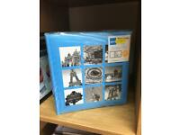 Photo albums in blue x3.
