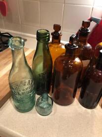 Antique glass bottles. Some with stoppers.