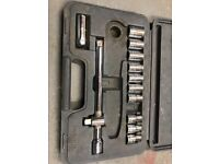 """Assortment of 1/2"""" sockets and extension bar"""