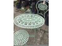 Oval bistro table and two chairs