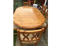 Pine extendible dining table and six chairs