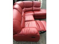 Deep red leather corner sofa with end recliner .. Excellent condition