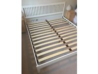 Super-king sized bed frame. White wood, good condition.