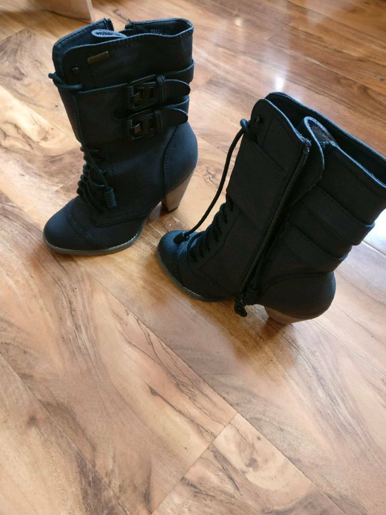 Womens boots in blackin Southsea, HampshireGumtree - Womens boots in size UK 4, with wooden heels. Perfect wear for summer. Zip detail with catwalk logo. Worn twice in excellent condition. Selling as moving abroad. From smoke free and pet free home