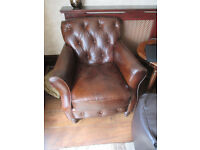 Pair of Small Distressed Leather Armchairs