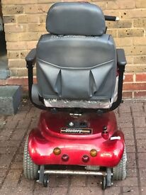 A beautiful Red mobility scooter for sale