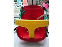 Plum plastic baby swing seat