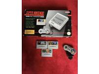 Super Nintendo SNES all boxed & complete 2 pads & 4games