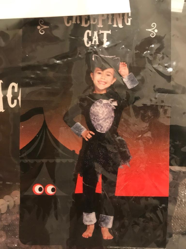Creepy Cat costume age 11-12 brand new with tags