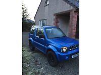 Suzuki Jimny sport, 4X4 Jeep in blue.