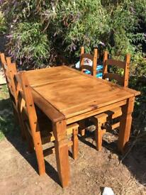 Dining table and 6 chairs. Solid wood