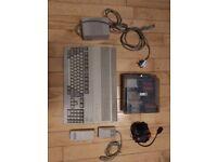 Amiga A500 w/ Joystick & Discs