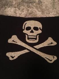 Skull and crossbones design cushions