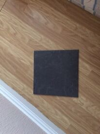Dark grey slate effect tiles, grout and adhesive