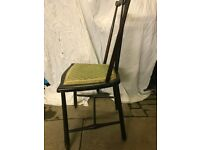 Vintage child's chair, black with green padded seat