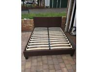 Brown fabric king size bed frame