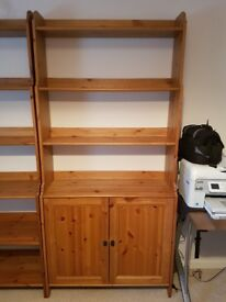 Book case - Tall teak effect bookcase with double cupboard at bottom. £55