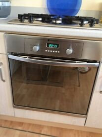 Gas hob and electric oven. Hotpoint