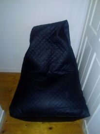 XL Kaikoo Black faux leather bean bag chair £ 40 never been used. Collection city centre.