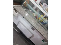 5 foot long very nice an clean fridge food display counter cake/desserts/food ect very good condtion