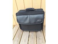 Sturdy black laptop case, wheels, folding handle, multiple compartments, great condition, back strap