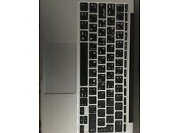 MacBook Air 11 inch laptop. No charger. Arabic/English keyboard