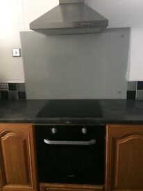 Samsung touch top hob with cooker and hood with splash back
