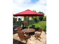 Wooden (teak) garden table and 4 chairs with parasol