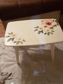 Vintage white 1950s coffee or side table with flower detail