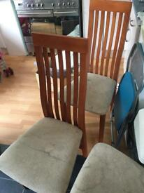 Solid wood table and 5 Chairs.