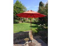 Terracotta coloured garden parasol with tilt action