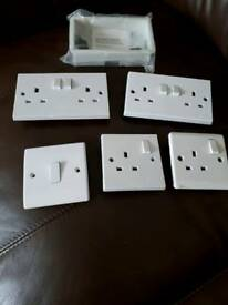 White double and single sockets, dry lining box and single light switch