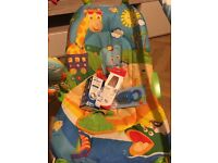 Baby play vibrating seat with a sound toy