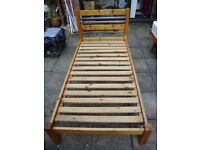 Single bed, solid chunky pine with very strong slats and very clean mattress