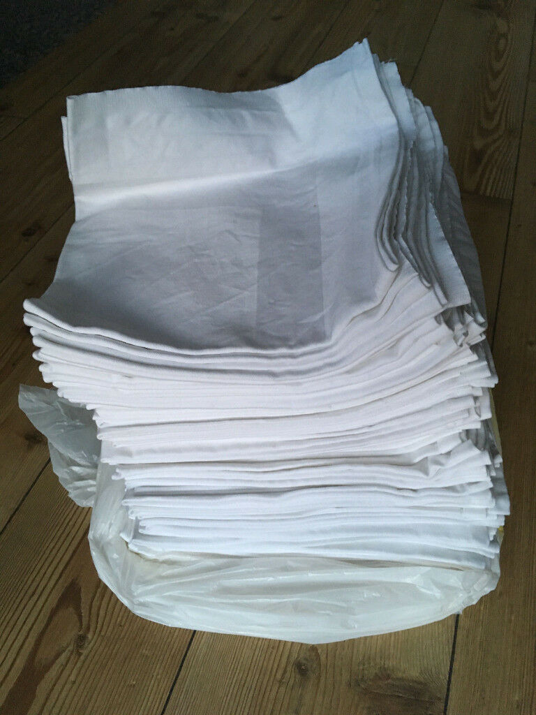 74 white cotton napkins 56x56cm, 100% cotton. Used once at a wedding. £60 ONO