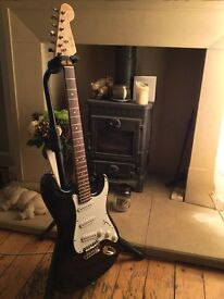 Electric guitar, Stratocaster style. ( may exchange for acoustic guitar ).
