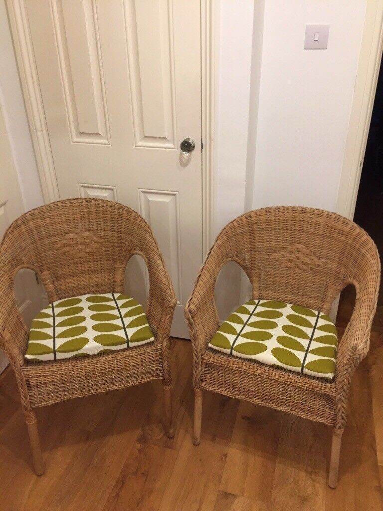 Pair of Java Wicker chairs with Orla Kiely fabric seat pads