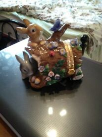 Easter bunny trinket box with flowers and butterflies.