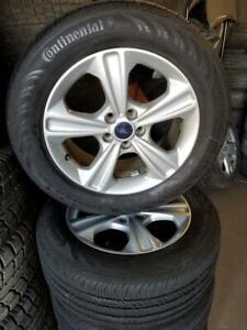 100% tread 235 55 17 Continental all season tires on OEM 2016 Ford Escape alloy rims 5x108 / TPMS