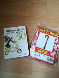 50th book and inflatable walking stick