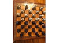 Intricate dragon chess set with heavy wooden chess board