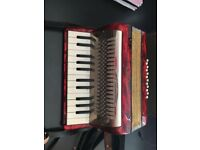 Vintage Accordion and music books for sale.