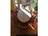 Country kitchen style farmhouse wooden oval dining table with 6 carver chairs with arm rests