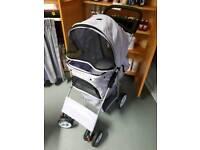 Purple spotty pet stroller
