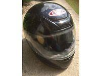 Black Apex motorbike helmet