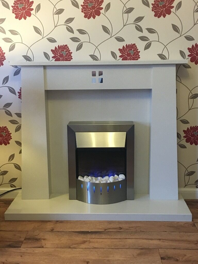 white marble feature fireplace with electric fire blue flame
