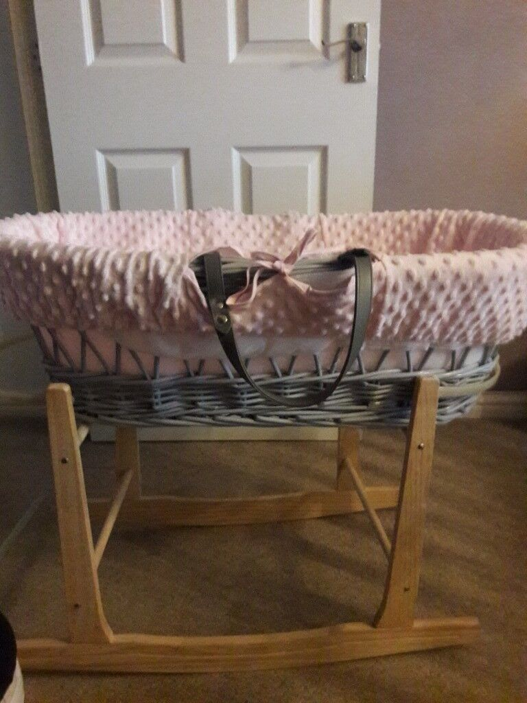 Pink moses basket as good as new including rocking stand.